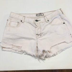 Free people white denim distressed shorts